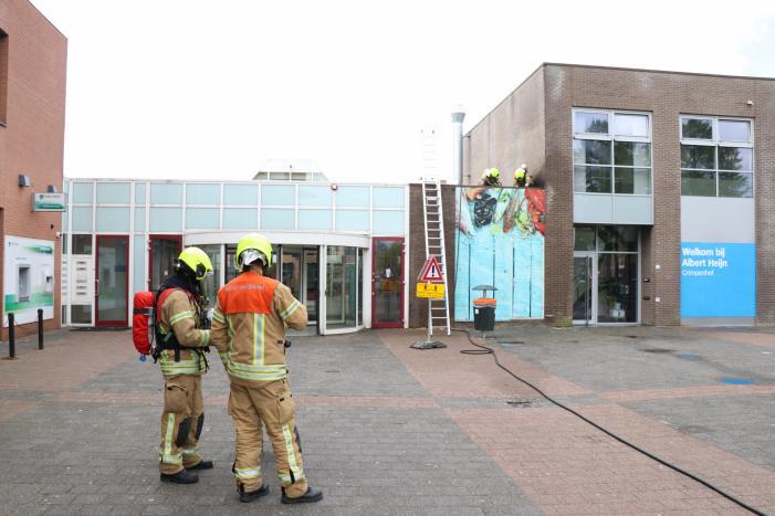 Brand in afvoerkanaal van winkel
