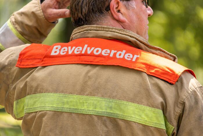 Brandweer blust flinke brand in loods