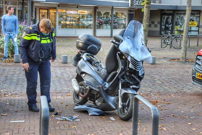 Ongeval tussen auto en scooter