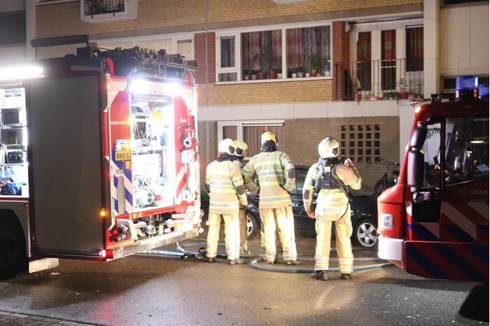 Bewoners gered na brand in portiekwoning