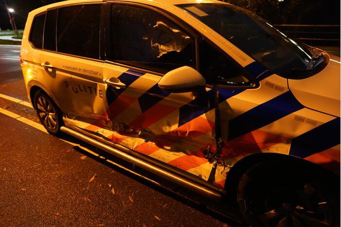 Schade aan politieauto na aanrijding