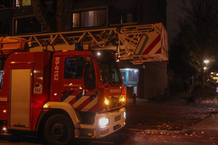 Onderzoek naar mogelijk brand in portiek