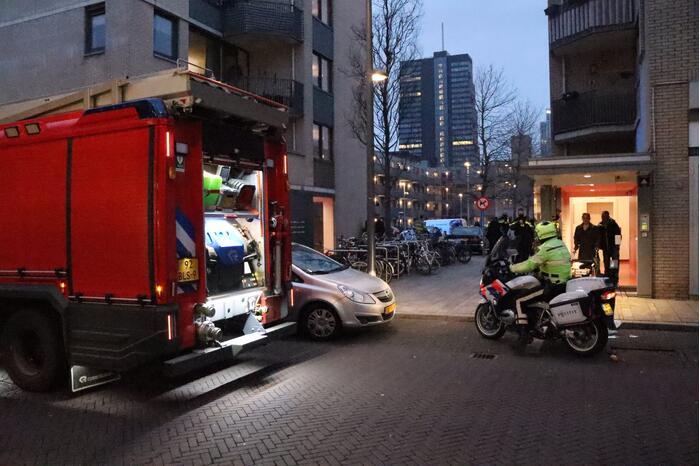 Brand in flatwoning boven winkels