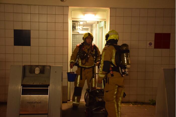 Brand in kelder van flatgebouw