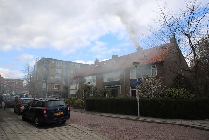 Veel rook bij brand in schoorsteen