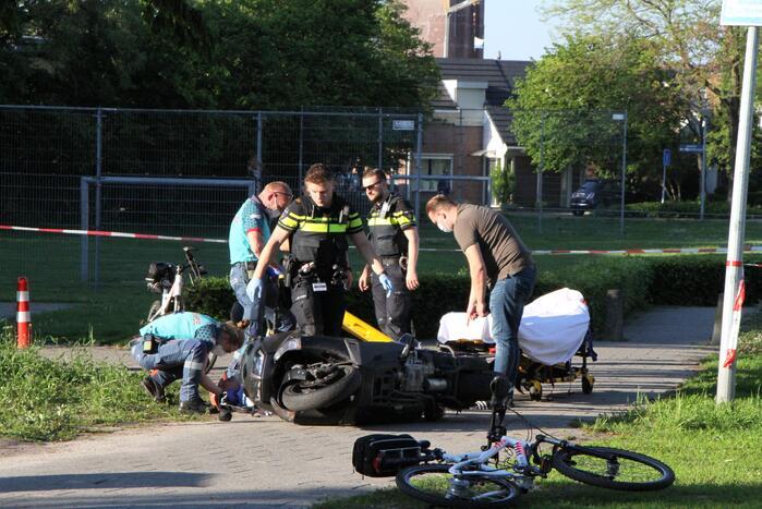 Persoon gewond na val met motorscooter