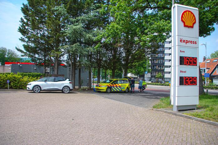 Ambulance en auto komen met elkaar in botsing