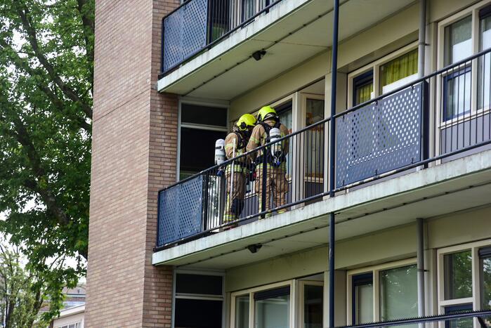 Bank in kelderruimte in brand gevlogen