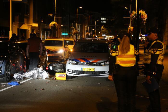 Scooterrijder en passagier gewond door ongeval met politieauto